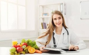 A nutritionist next to fruits and vegetables.