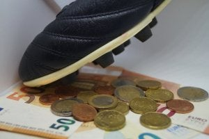 Euros next to soccer cleats.