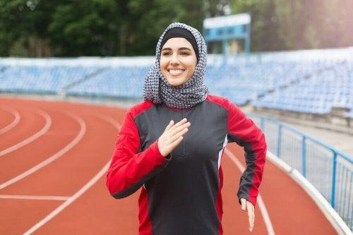 Female muslim athlete running
