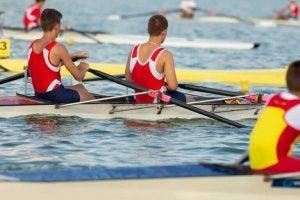 Men rowing on a lake.