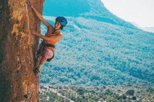 Woman rock climbing outside.