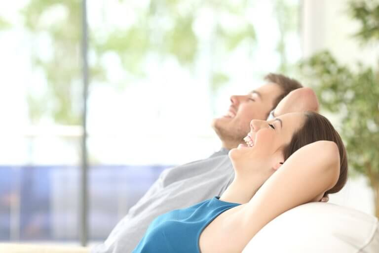 A man and a woman resting and relaxing to avoid damage to their joints