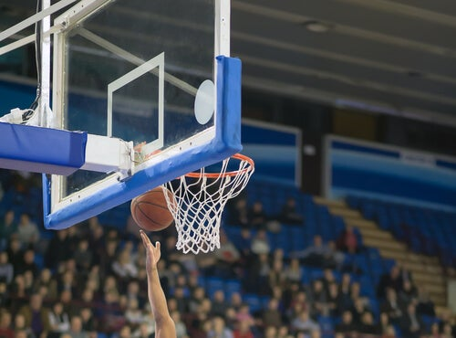 A basketball player socoring a point during the game
