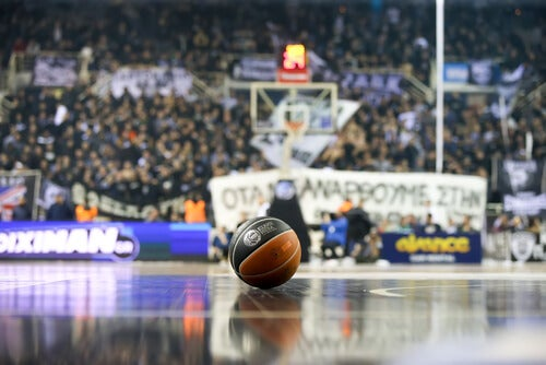 A basketball in the middle of the court to simbolize an important sport in the United States