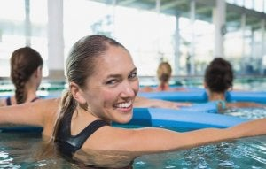 A group of women doing aquatic therapy.