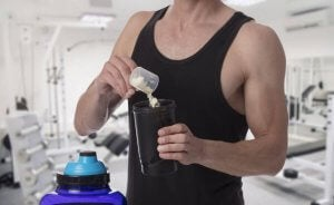 A man preparing some bodybuilding supplements.