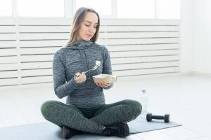 A woman eating an alkaline diet to regulate her pH levels.