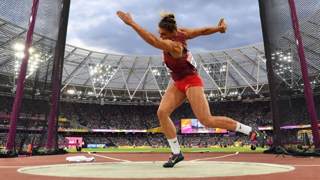 A woman throwing the discus.