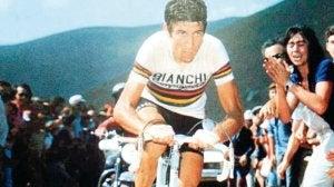 Felice Gimondi riding by a crowd.