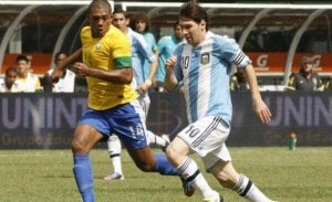 Messi playing in one of the hottest soccer rivalries.