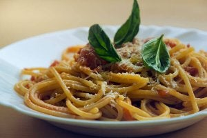 Pasta with red sauce and basil.