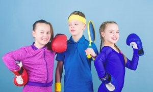 Three children ready for physical exercise.