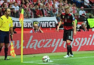 Toni Kroos taking a corner at the 2014 World Cup.