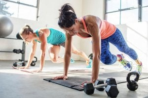 Women doing strength training at home.