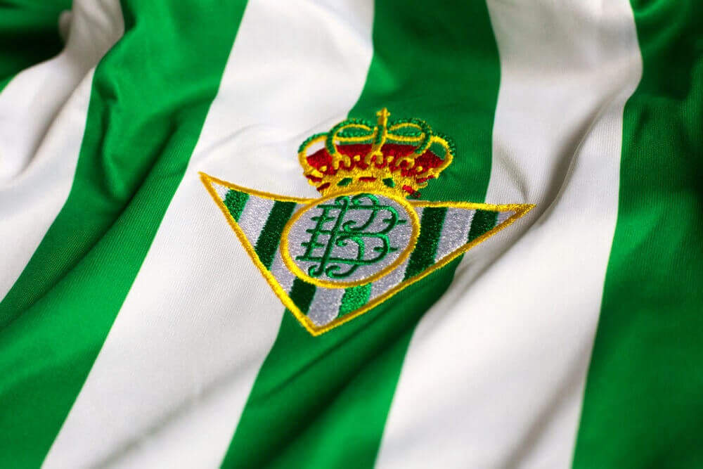 The greem emblen of the Real Betis FC portrays a crown as they are one of the Spanish teams with a royal title