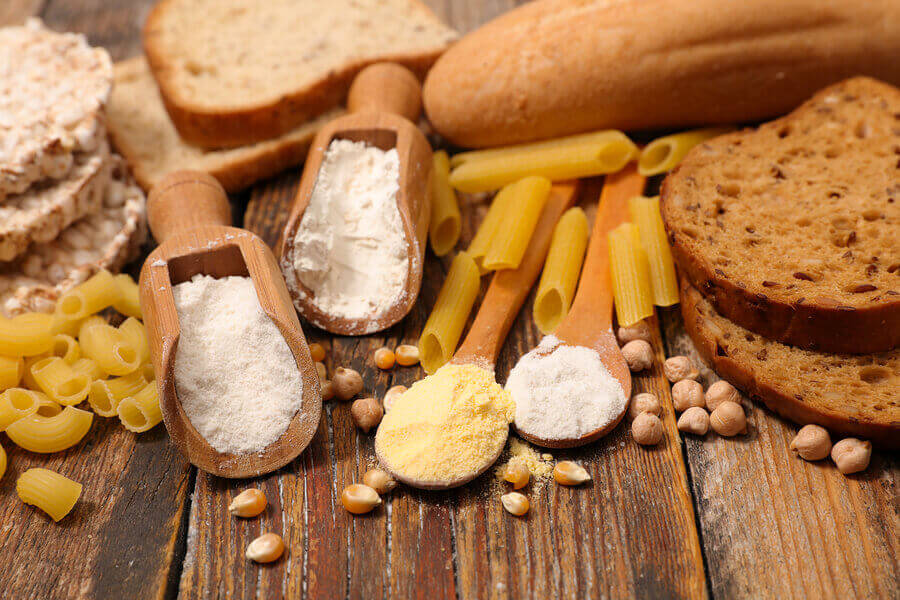 A variety of foods with high gluten content like pasta, bread and flour
