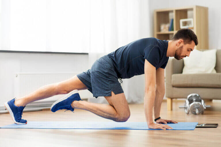 A man following a home exercise routine to reduce stress during quarantine