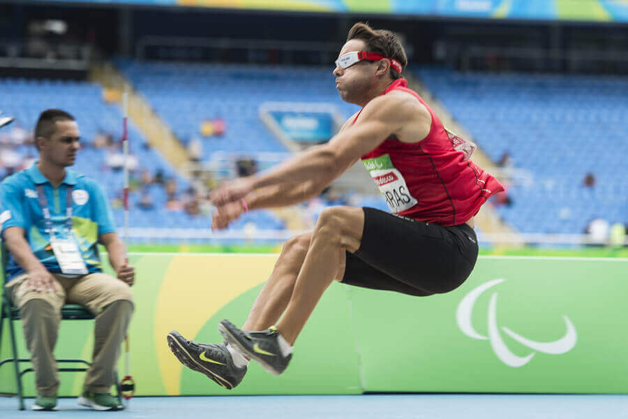 A disabled athlete participating in a Paralympic sport event organized by the Spanish Paralympic Committee