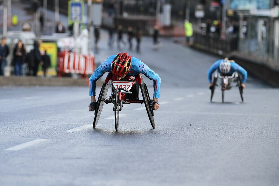 Two disabled athletes in the middle of a Paralympic competition