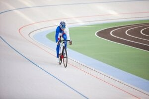 A cycling racing on a velodrome.
