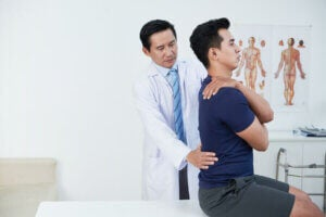 A man at the doctors to prevent lower back pain.