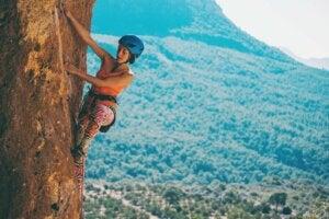 A woman climbing a cliff.
