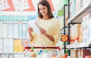 A woman reading nutrition labels at the store.