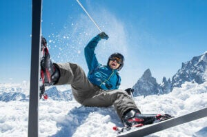 A man falling while skiing.