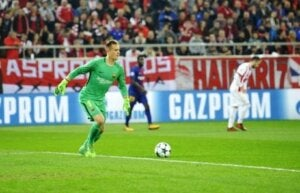 A goalkeeper about to kick the ball.