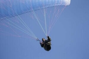 A man falling with a parachute.