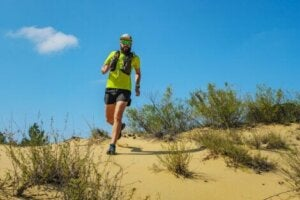 A man trail running, which is just one of many desert adventure sports.