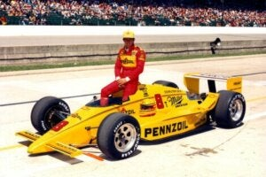 Rick Mears on his yellow car.