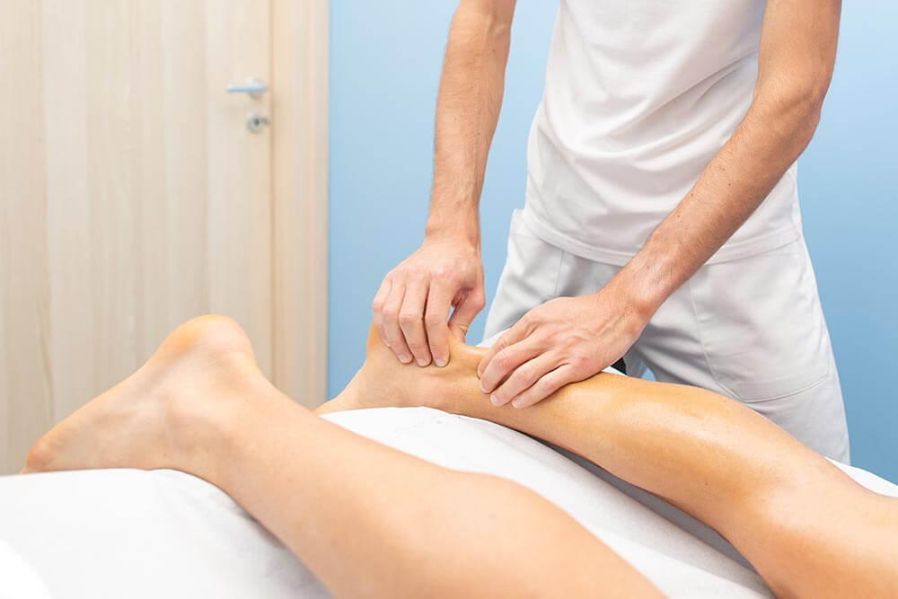A person getting physical therapy to recover from an Achilles heel rupture