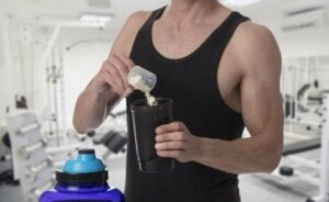 An athlete adding supplements to his drink.