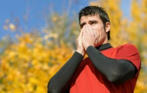 A runner suffering from allergies whilst outside.