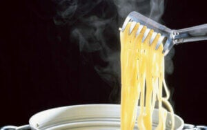 Pasta being lifted from the pan.