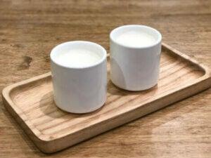 Two mugs of warm milk.