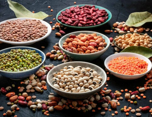 Bowls full of different legumes and beans.