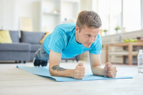 A man doing bodyweight tricep extensions to strengthen his arms