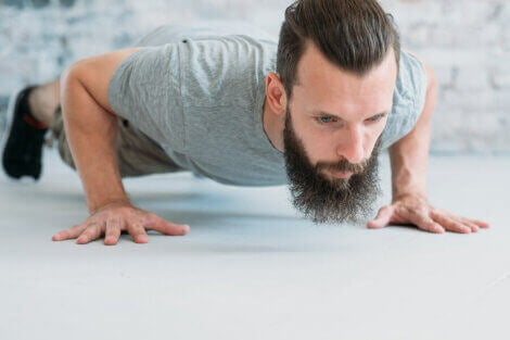 A man doing push ups to strengthen his triceps