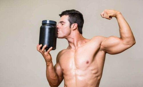 A man kissing a bottle of protein powder.