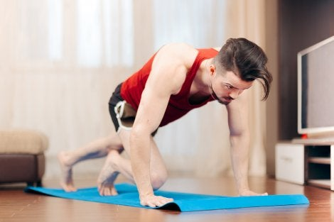 A man doing mountain climbers during a functional training circuit
