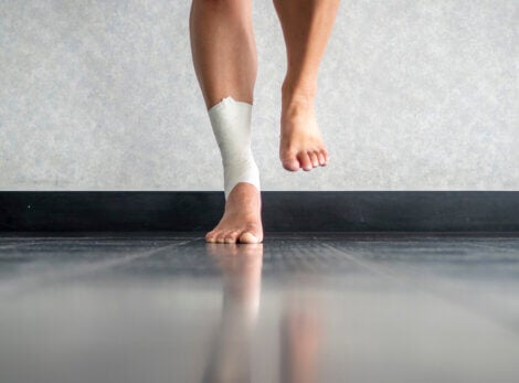 A man doind proprioceptive balance exercises to recover the sensation in his injured ankle