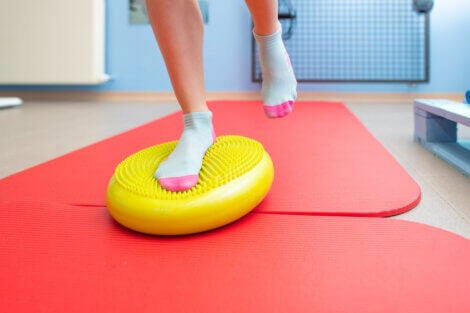 Doing proprioceptive exercises on top of a balance trainer