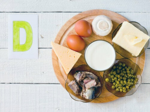 Different foods with vitamin D on a circular cutting board including dairy products, eggs, meat.