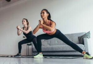 Two women doing a workout routine.