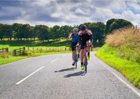 Two cyclists training on road