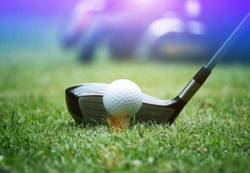 A golf club on a tee.