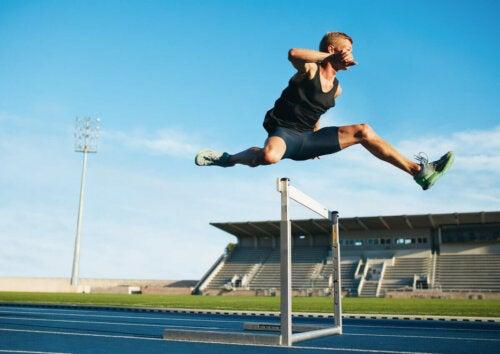 A man running a hurdle race.