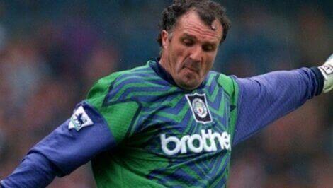 John Burridge playing football.